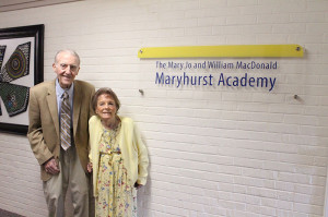 Members of the Maryhurst Legacy of Hope Society, William and Mary Jo MacDonald, outside the Maryhurst Academy which has been named in their honor.